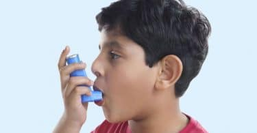 landscape boy using asthma inhaler